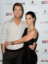 Eric Winter and Roselyn Sanchez at the Hollywood Reporter's philanthropist of the year Award Reception.