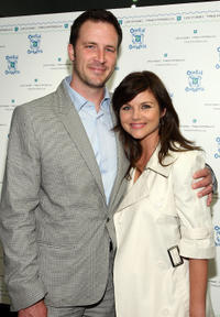 Brady Smith and Tiffani Thiessen at the OneKid OneWorld's shop for a cause in California.