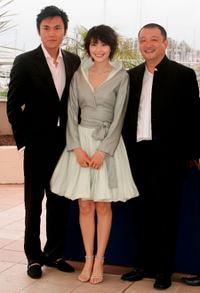 Qin Hao, Yuanyuan Gao and director Wang Xiaoshuai at the 58th International Cannes Film Festival.