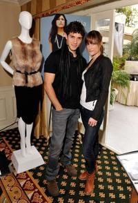 Michael Rady and Rachael Kemery at the Illia display during the 67th Annual Golden Globe Awards.