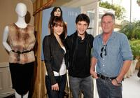 Michael Rady, Rachael Kemery and Guest at the Illia display during the 67th Annual Golden Globe Awards.