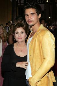 Carrie Fisher and Steven Strait at the Los Angeles premiere of