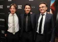 Christian Colson, James Franco and director Danny Boyle at the New York premiere of