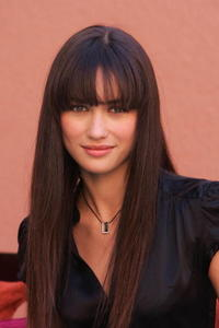 Olga Kurylenko at a photocall for