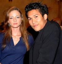 Katharine Towne and Dante Basco at the party of director John Singleton.