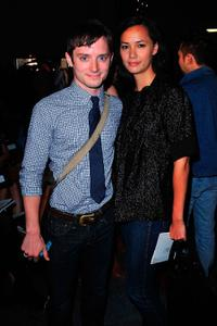 Elijah Wood and Pamela Racine at the Rodarte Spring 2010 fashion show.