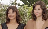 Julie Bataille and Maggie Gyllenhaal at the photocall of