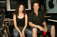 Mandy Gonzalez and Terrence Mann at the John Lennon Educational Tour Bus.