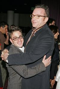 Eric Gores and Tom Arnold at the premiere of