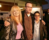 Penelope Spheeris, Tom Arnold and Eric Gores at the premiere of