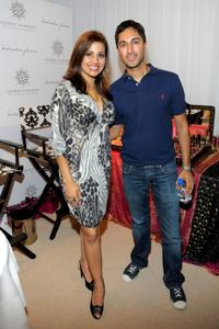 Maulik Pancholy and Guest at the HBO Luxury Lounge in honor of the 60th Annual Primetime Emmy Awards.