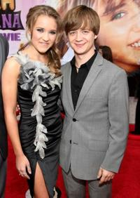 Emily Osment and Jason Earles at the premiere of