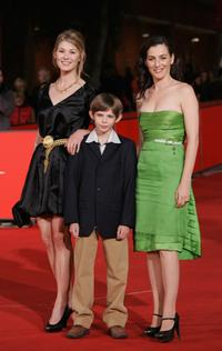 Rosamund Pike, Robbie Kay and Ayelet Zurer at the premiere of