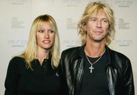 Susan Holmes and Duff McKagan at the Playstation 2 Triple Double Celebrity Gaming Tournament.