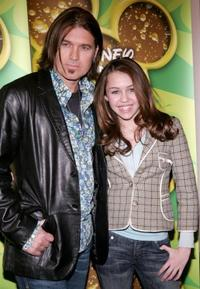 Billy Ray Cyrus and daughter Miley Cyrus poses as Stars of the Disney Channel at the Splashlight Studios.