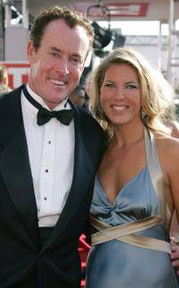 John C. McGinley and guest at the 57th Annual Emmy Awards.