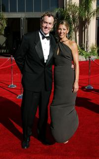 John C. McGinley and guest at the 58th Annual Primetime Emmy Awards.
