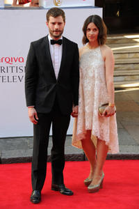 Jamie Dornan and Amelia Warner at the Arqiva British Academy Television Awards in London.