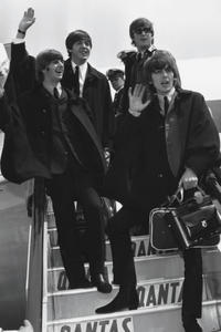 The Beatles wave to fans in 1964.