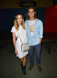 Gillian Zinser and Luke Grimes at the Tommy Hilfiger celebrates Surf Shack in California.