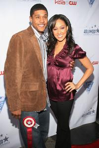 Pooch Hall and Tia Mowry at the 75th Annual Hollywood Christmas Parade.