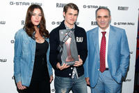 Liv Tyler, Magnus Carlsen and Garry Kasparov at the G-Star Raw World Chess Challenge in New York.
