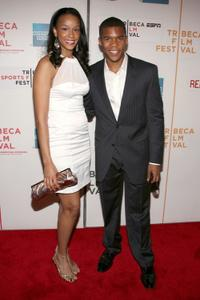 Whitney McCauley and Gaius Charles at the premiere of