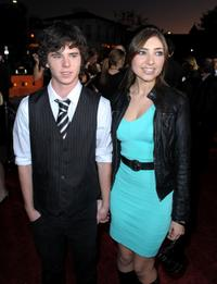 Charlie McDermott and Guest at the premiere of