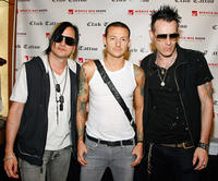 Amir Derakh, Chester Bennington and Ryan Shuck at the autograph signing session during the grand opening of Club Tattoo in Nevada.