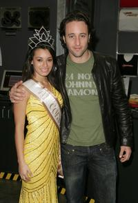 Alex O'Loughlin and Guest at the Celebrity Racing Charity event.