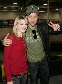 Kathryn Morris and Alex O'Loughlin at the Charity Racing event.