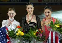 Sasha Cohen, Michelle Kwan and Shizuka Arakawa at the 2004 World Figure Skating championships.