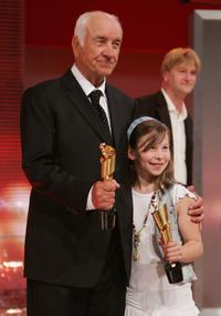 Armin Mueller-Stahl and Zoe Mannhardt at the German Film Award, hold their Lola Awards for Lifetime Achievement and Best Children's Film.