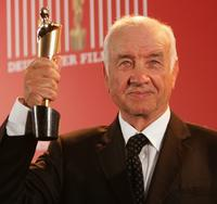 Armin Mueller-Stahl at the German Film Award, holds his Lola Award for Lifetime Achievement.