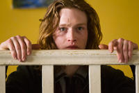Caleb Landry Jones as Frank in
