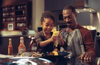 Yara Shahidi as Olivia Danielson and Eddie Murphy as Evan Danielson in