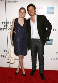 Adam Rothenberg and Guest at the premiere of