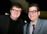 Director Michael Moore and Michael Musto at the screening of