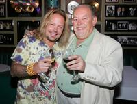 Vince Neil and Robin Leach at the tasting of Neil's Vince Vineyards wines.