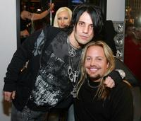 Criss Angel and Vince Neil at the Tattoo Parlor grand Opening.