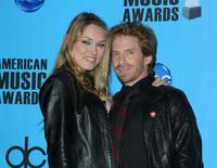 Clare Grant and Seth Green at the American Music Awards.