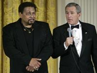 Aaron Neville and George W. Bush at the evening honoring the governors of all the US states and territories.