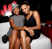 Jill Marie Jones and Guest at the reveal and launch party of LG Electronics' (LG) Scarlet HD TV series.