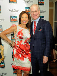 Tim Gunn and Guest at the iPhone App Launch of