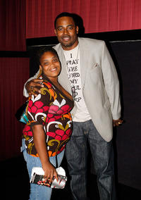 Lamman Rucker and Guest at the premiere of