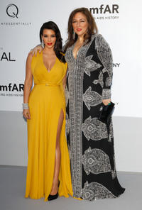 Kim Kardashian and Guest at the 2012 amfAR's Cinema Against AIDS during the 65th Annual Cannes Film Festival.