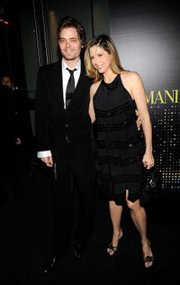 Christopher Backus and Mira Sorvino at the Giorgio Armani 5th Avenue Store Opening Reception in New York.
