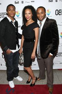 Chris Warren Jr., Brook Kerr and Chris Warren Sr. at the premiere of