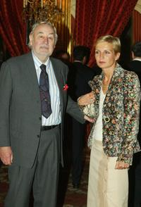Philippe Noiret poses with Melita Toscan Du Plantier at the Elysee Palace prior to the Cannes Film Festival.