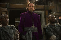 Gary Oldman as Father Solomon in